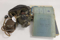 A World War II brown leather pilot's head set, together with Royal Air Force log book, aircraft spotting book, war lamp and other related booklets. (Q)