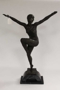 After D. H. Chiparus : A bronze study depicting an Art Deco style dancer with knee raised, on black marble plinth.