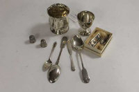 A silver egg cup, together with four items of silver cutlery, two thimbles etc. (Q)