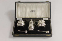 A silver three piece silver cruet set, retailed by Reids of Newcastle upon Tyne, cased.