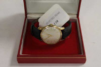 A 9ct gold Gentleman's Omega wrist watch, boxed with original paperwork.