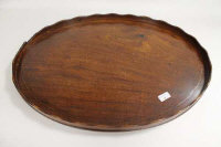 A nineteenth century inlaid mahogany oval butler's tray, width 70 cm.