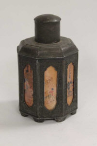 A Chinese octagonal pewter caddy, with panelled sides decorated with figures, height 18 cm.