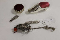 A silver pin cushion modelled as a shoe, together with four other items of sewing interest. (5)