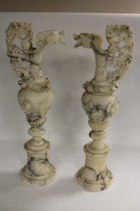 An impressive pair of white variegated marble ewers, height 77.5 cm. (2)