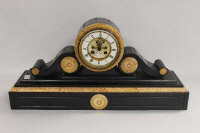 A ninenteenth century marble and black slate mantle clock, width 64 cm.