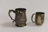 An early ninteenth century silver embossed tankard, together with a silver christening mug. (2)