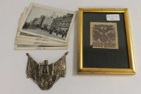 A rare Third Reich hollow die stamped device for the Wehrmacht standard bearer's Gorget, together with a bookplate and a collection of monochrome postcards depicting views of Hamburg. (Q)