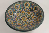 A Persian designed pottery bowl, width 31 cm.