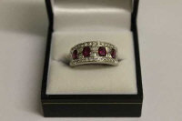 An 18ct white gold diamond and ruby ring.