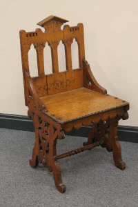 A late Victorian gothic style hall chair.