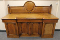 A late Victorian oak inverted-breakfronted sideboard, width 211 cm.