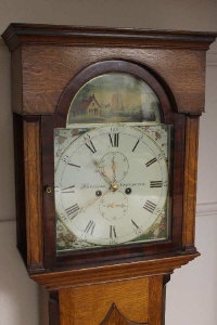 A nineteenth century long cased clock by Harrison of Newcastle upon Tyne, height 211 cm.