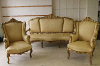 A nineteenth century gilt wood three piece lounge suite, comprising of pair of armchairs and three seater settee. (3)