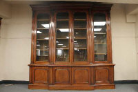A Victorian mahogany breakfront four door library bookcase, width 252 cm.