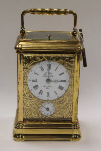 A French brass carriage clock, by Sainte-Suzanne, height 14.5 cm.