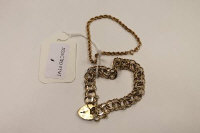 A 9ct gold double chain link bracelet with heart clasp, 18.6g, together with a small rope-twist bracelet stamped 10K. (2)