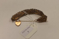 A 9ct gold flat-linked bracelet with heart clasp, 28.4g.