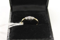 An 18ct gold three stone diamond ring, approximately 0.25ct.
