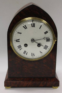 A nineteenth century burr walnut mantle clock, on brass bun feet, height 25.5 cm.