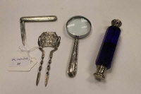 A silver hair slide, Birmingham 1903, together with  a blue glass double scent flask, a silver fruit knife and silver handled magnifying glass. (4)