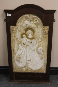 A late nineteenth century plaster panel depicting Madonna Della Rosa, in wooden frame, height 86.5 cm.