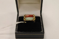 A 14ct gold two tone jade ring.