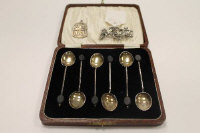 Six silver coffee spoons, cased, together with a silver A.R.P. badge and a silver marcasite floral brooch.