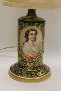 An early twentieth century Bohemian green glass table light, the textured panelled sides with white overlay profusely gilded and decorated with the portrait of a lady with ribbons in her hair, base height 22 cm.