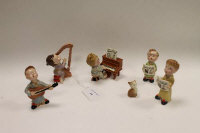 A Beswick Bedtime Chorus set comprising Girl with Harp 1826, Pianist and Piano 1802, Boy with Guitar 1825, Cat 1803, Boy with Spectacles 1805 and Boy without Spectacles 1804. (7)