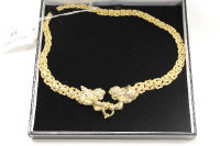 A 14ct gold necklace with cupid clasp, 38.2g.