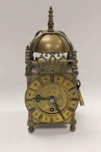 A brass lantern clock, with key, height 25.5 cm.