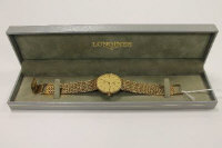 A 9ct gold Longines  Presence wrist watch, 44.5g.