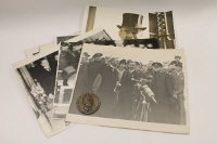 A collection of seventeen period official press photographs depicting Neville Chamberlin and others, together with a bronze medallion struck by his supporters for his achievements at the Munich conference 1938. (18)