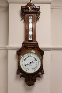 An Edwardian carved oak barometer by B & A Butterfield.
