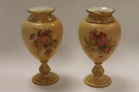 A pair of Royal Worcester blush ivory gilded urns, shape 2260, height 14.5 cm.  (2)