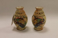 A pair of Locke & Co Worcester miniature blush ivory vases decorated with peacocks, height 11 cm. (2)