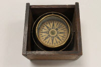An early twentieth century marine compass, cased in oak.