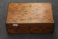 A nineteenth century inlaid mahogany writing box with star decoration, width 41 cm.