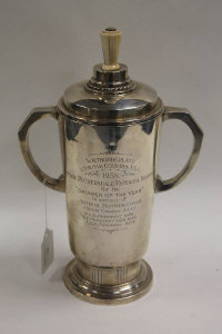 A silver trophy, Sheffield mark, date stamp 1932, with ivory finial, height 30 cm, 934 g.