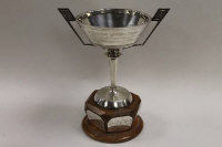 A silver trophy, Birmingham mark, date stamp 1966, on wooden silver mounted base, 500 g.