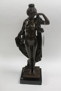 After Moreau - Bronze study of a partially robed lady, on marble plinth, height 42.5 cm.