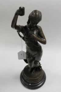 After Moreau - Bronze study of a lady holding a dove, on marble socle, height 47 cm.
