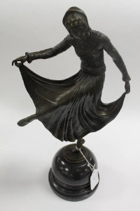 A bronze study of an Art Deco style dancer, on marble socle, height 46 cm.
