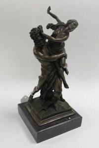 A bronze study of Neptune carrying a maiden, on marble plinth, height 36 cm.