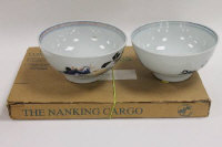 A pair of Nan King cargo blue and white china bowls, together with the Christie's catalogue, with labels, diameter 15 cm. (3)