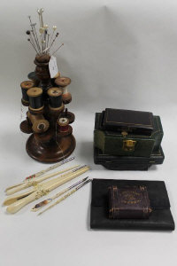 A late Victorian mahogany bobbin stand, together with vintage glove stretchers and sewing sets etc. (Q)