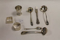 A silver egg cup, together with two silver napkin rings and five items of cutlery. (8)