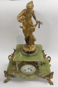 A late  nineteenth century green marble ormolu mounted mantle clock, height 53 cm.