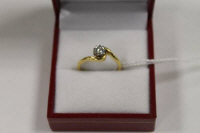 An 18ct gold diamond solitaire ring on twist setting.
